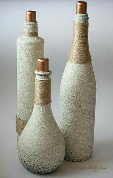 Looks like stone or textured spray paint and jute string #decoratedwinebottles #...