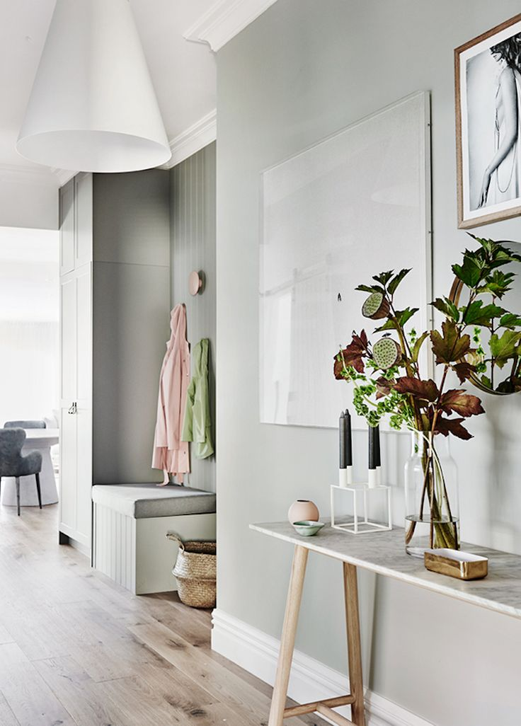 A white and grey hallway in a Scandi-inspired family home in a 1950's bungal...