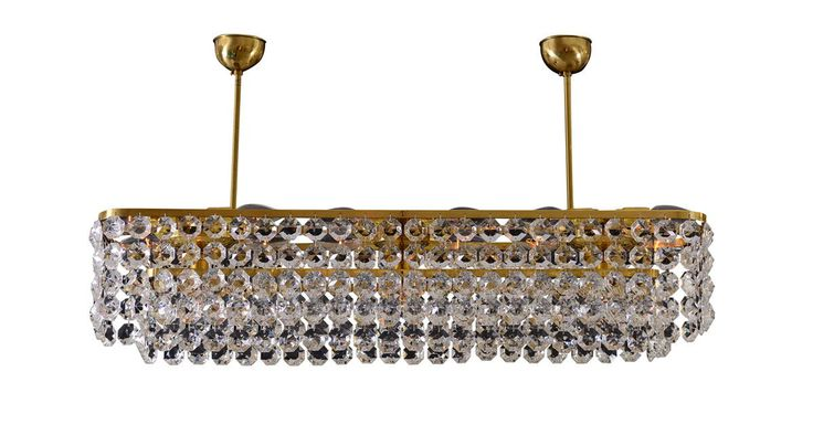 #DailyProductPick The Oberwalder Chandelier by Woka is made with brass and hand-...