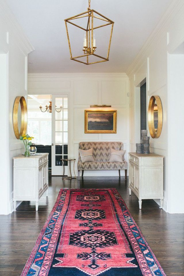 Neutral entryway with colorful rug