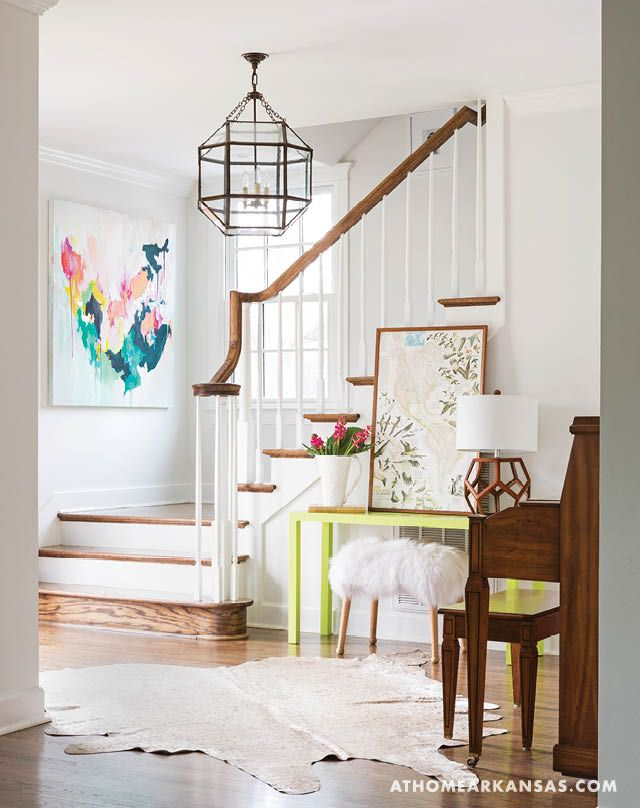 Eclectic entryway with lime green console table