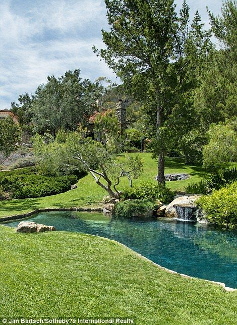 A waterfall design element in included in the pool belonging to the Hollywood A-...