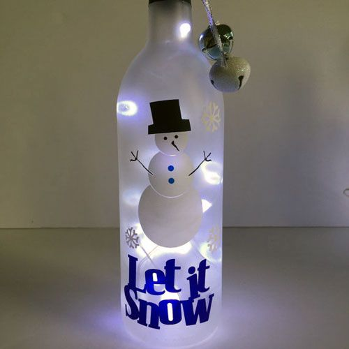 Let It Snow decal on lighted bottle.