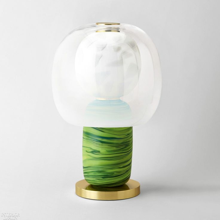 Fusa, a totemic lamp series was developed by cutting and layering Josef Frank fa...