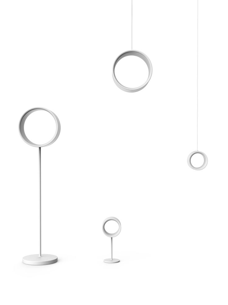 Placing a hand inside the central void of the table lamp version of Lost by Brog...