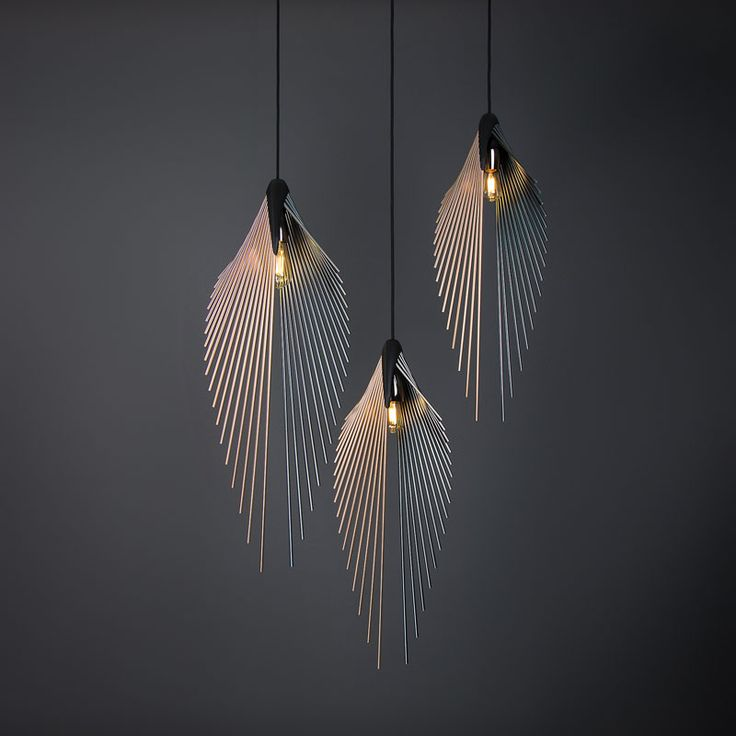 This modern pendant light's shape is defined by the anodized aluminium poles, fi...