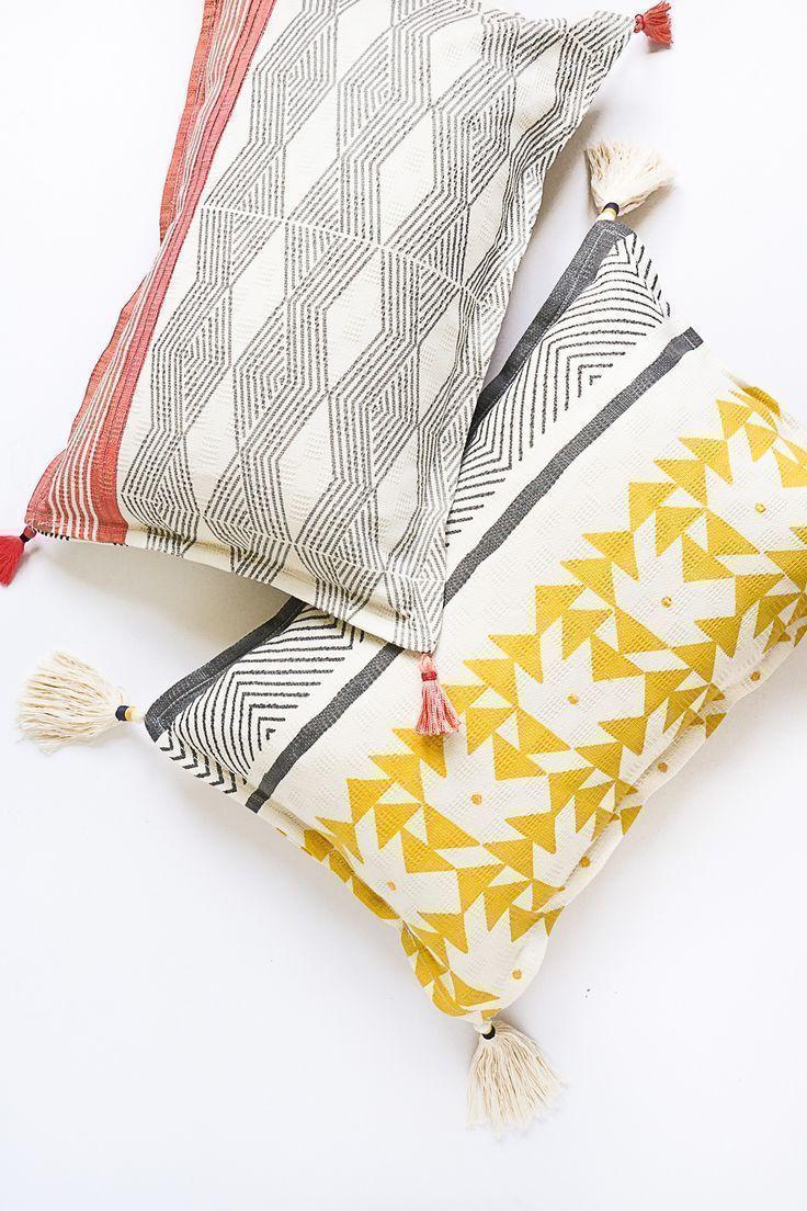 DIY Tasseled Throw Pillows by Ashley Rose of Sugar & Cloth, a top lifestyle blog...