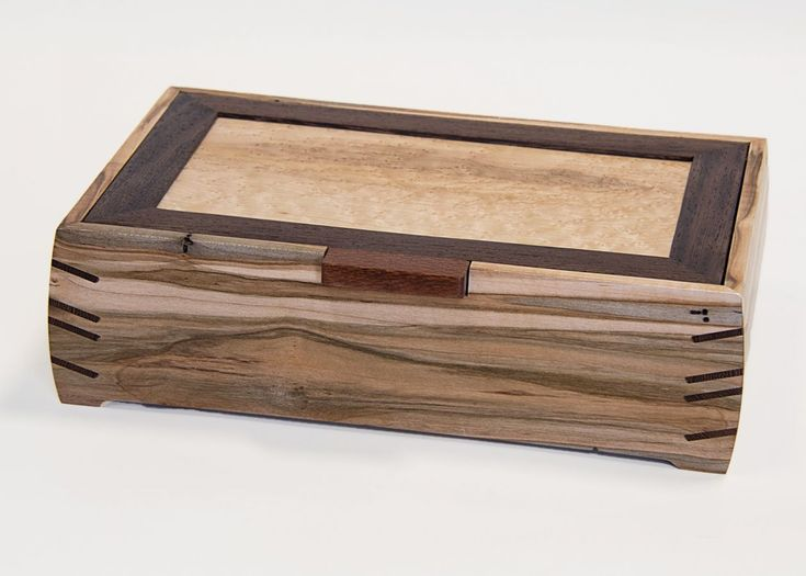 This stunning Jewelry box is created from ambrosia maple.The body is joined by ...