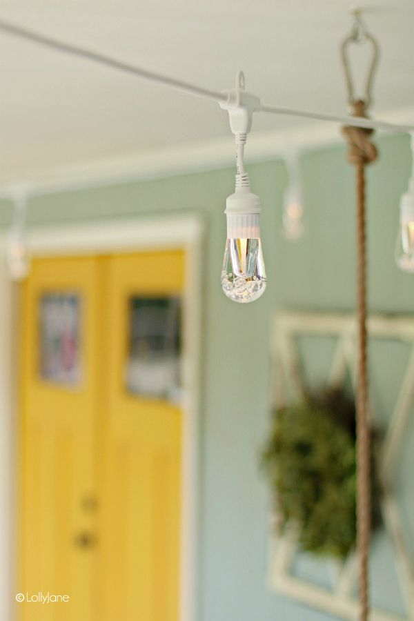 Love these backyard string lights on this cottage porch, so cute. These heavy du...