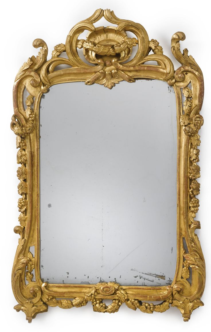 A Louis XV/XVI transitional carved giltwood mirror circa 1765 the frame carved w...