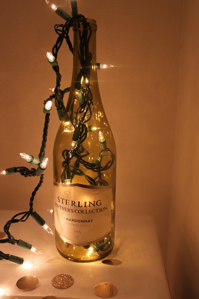 Lights in a wine bottle  (cool idea for barn wedding and use the cork name tags!...