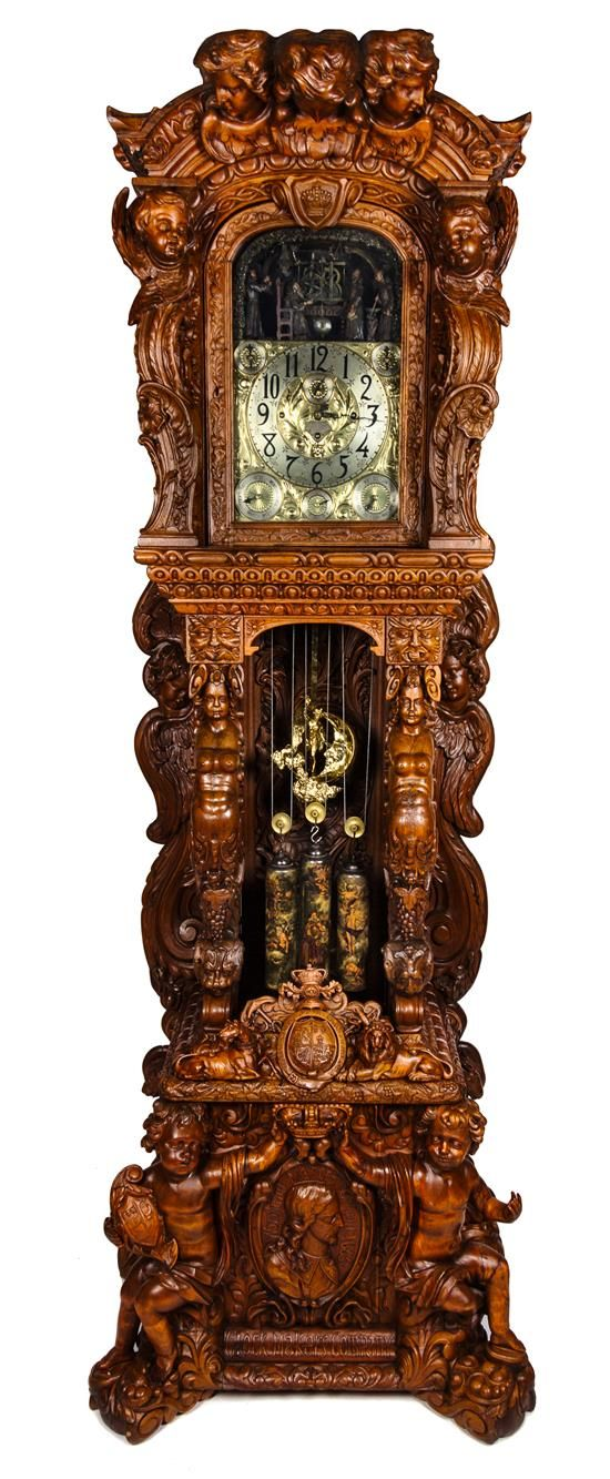A Monumental English Carved Oak Tall Case Clock