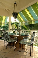 Barry Dixon, St. Barts dining porch - love the colorful deep awnings, trestle ta...