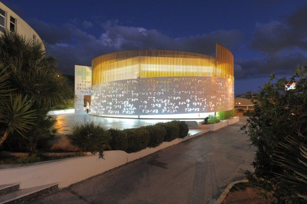 klab Architecture designed a pharmacy in Athens, Greece, that looks like a spira...