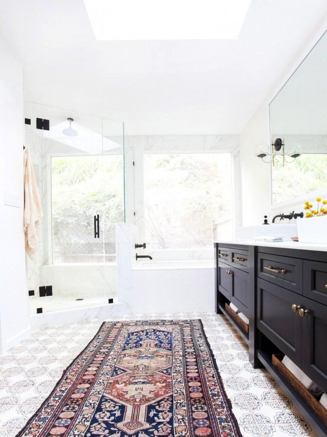 A vintage Persian rug is in a modern bathroom