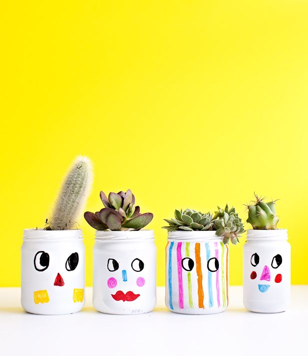 KID-MADE FUNNY FACES PAINTED PLANT JARS