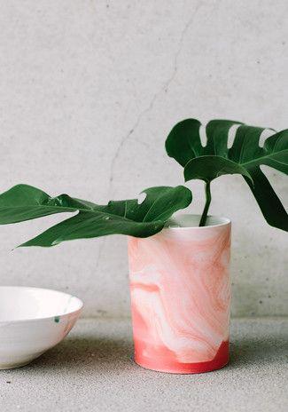 Marbled vase & big leaves.