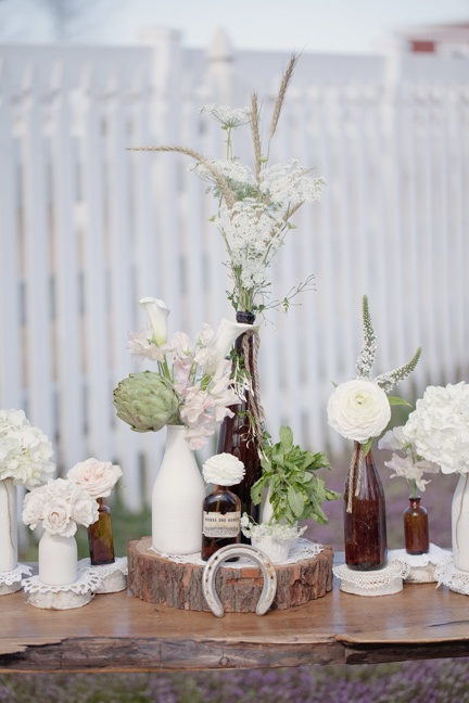 We love our new round wood centerpiece displays just finishes off that rustic lo...