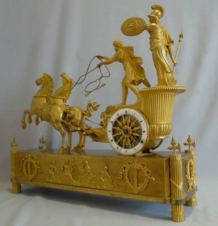 ** French Empire antique mantel clock of Minerva riding the chariot of Diomedes....
