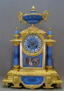 French antique clock set in porcelain and ormolu with silver