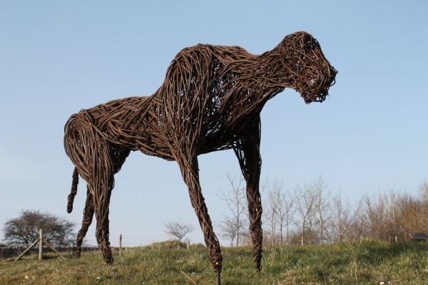 'The Blackdown Beast (Woven Willow Animal statue)' by Sophie Courtiour