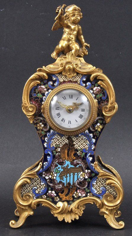 A 19th century french ormolu and champleve enamel mantl
