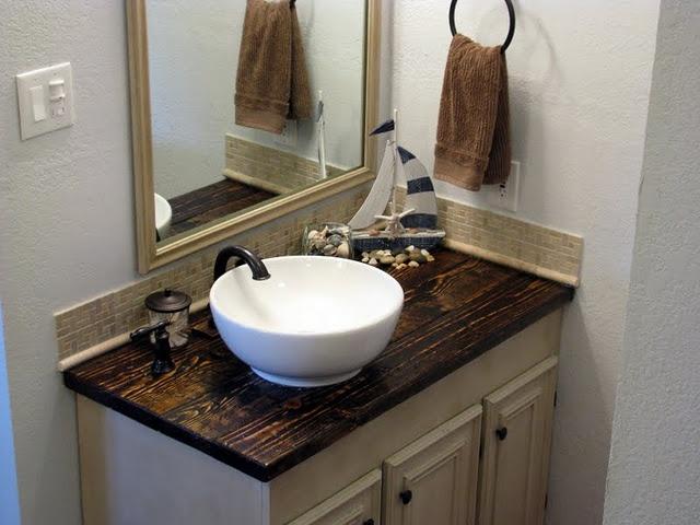Love this DIY bathroom!  Especially the countertop!!