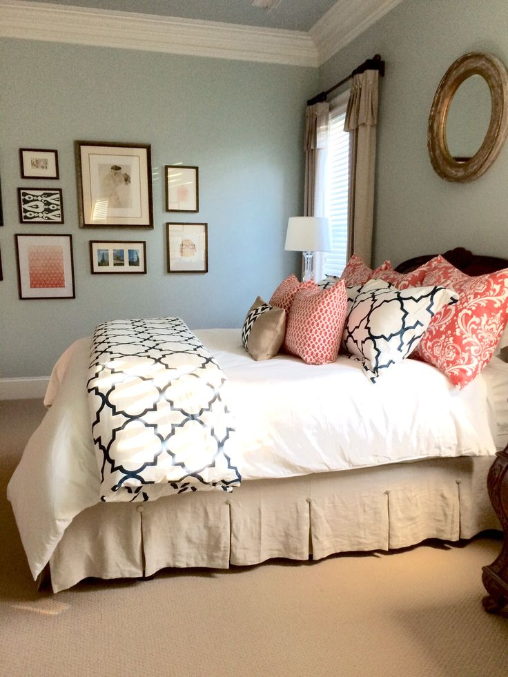 Linen, navy, and coral bedroom