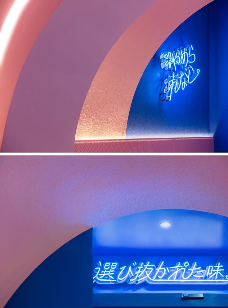 In this modern ramen restaurant, neon signs have been used to create focal point...