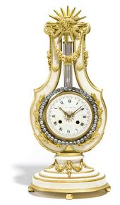A Louis XVI style gilt bronze and marble mantel clock  late 19th century