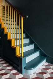 Office S&M uses scale-like tiles and bright colours to update London home